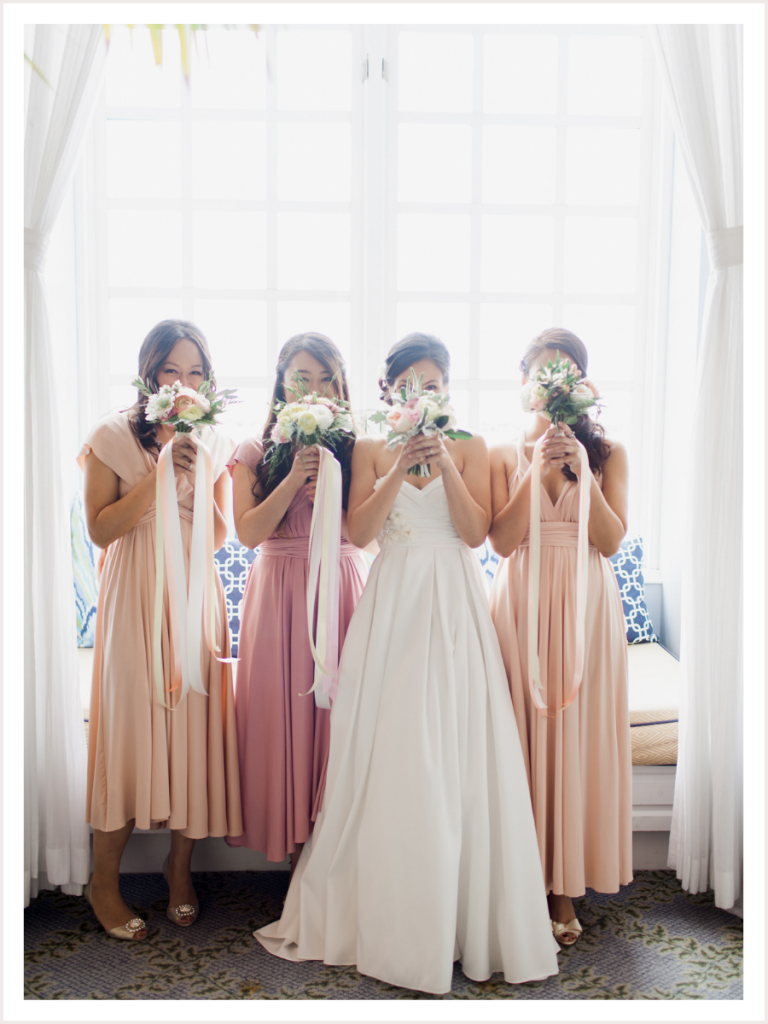 Bride with her bridesmaids holding bridal bouquets