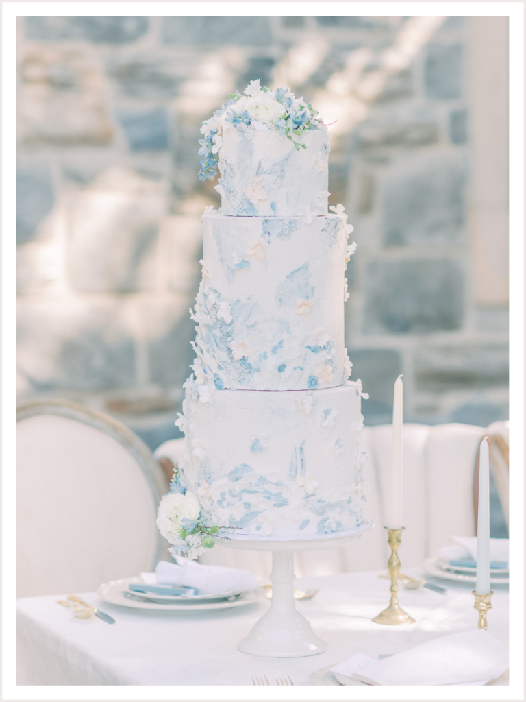 wedding cake on top of reception table