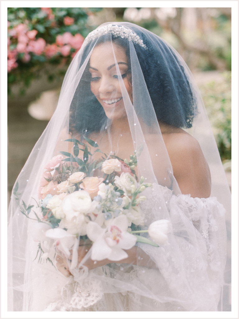 bridal portraits of bride holding her bouquet