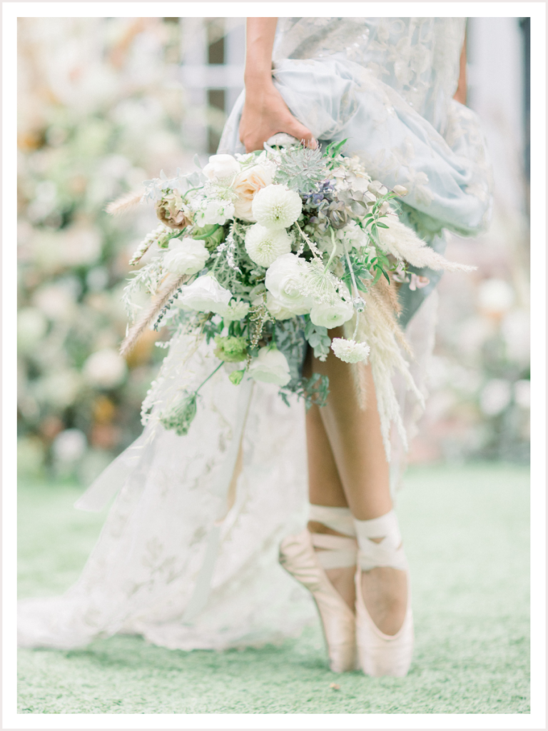 Ballerina Bride in pointe shoes holding a bridal bouquet