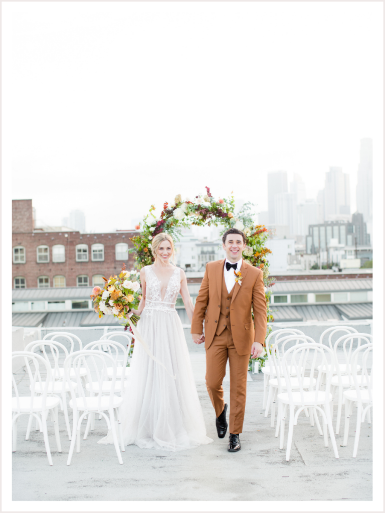 Bride and groom on a rooftop getting married